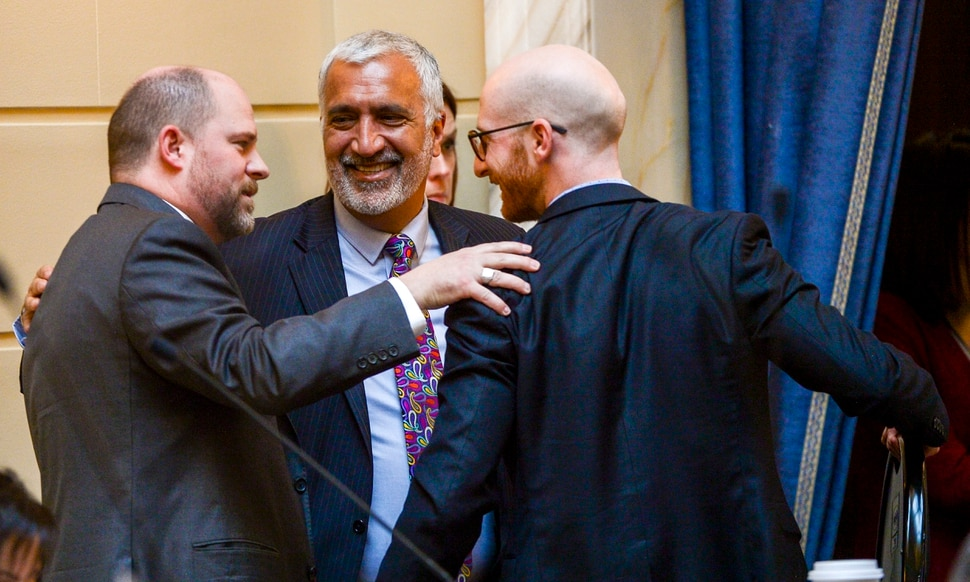 Leah Hogsten   The Salt Lake Tribune l-r Sen. Daniel Thatcher, R- West Valley City, celebrates the initial approval of his hate crimes bill with Salt Lake County District Attorney Sim Gill and Sen. Derek Kitchen, D-Salt Lake City. Thatcher's SB103 bill would allow judges to increase penalties for a crime if a defendant is convicted of targeting someone based on ancestry, disability, ethnicity, gender identity, national origin, race, religion or sexual orientation. A person must first be convicted of a crime before additional penalties would apply. There have been no successful convictions under the state's current hate crimes law.