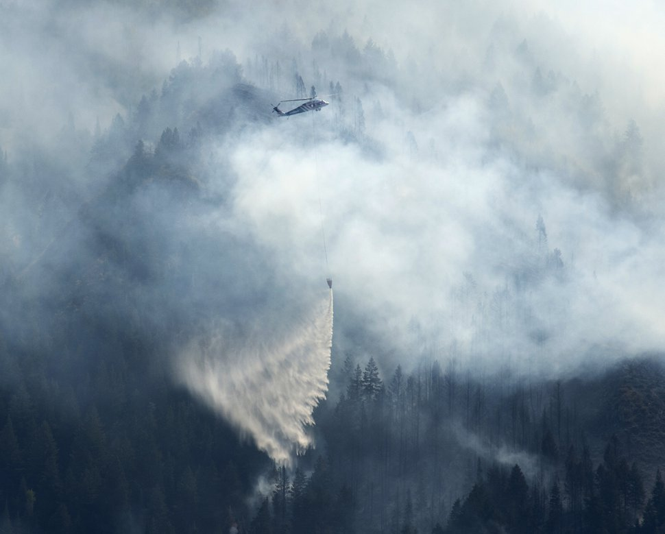 (Rick Egan | The Salt Lake Tribune) A helicopter drops water on the Bald Mountain Fire near Woodland Hills, Tuesday, Sept. 18, 2018.