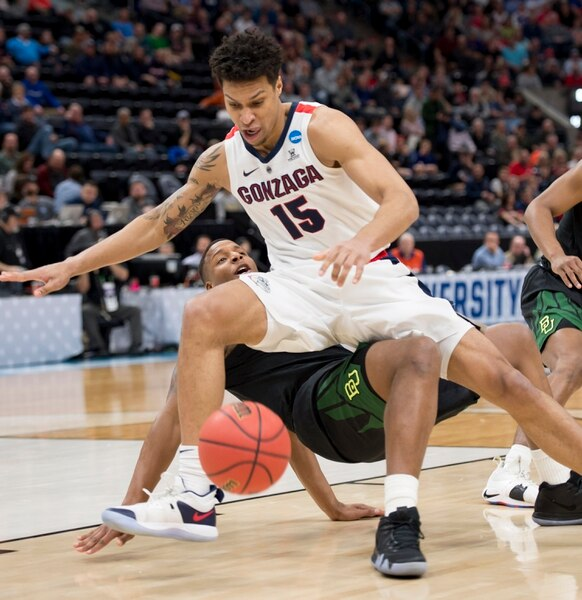 (Leah Hogsten | The Salt Lake Tribune) Gonzaga Bulldogs forward Brandon Clarke (15) collides with Baylor Bears guard Mark Vital (11) as Baylor faces Gonzaga in the second round of the NCAA tournament in Salt Lake City on Saturday, March 23, 2019.