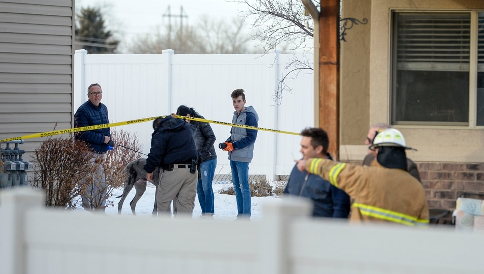 (Leah Hogsten | The Salt Lake Tribune) Weber County emergency personnel and firefighters work the scene of a small, private plane that crashed in a residential neighborhood in Roy, Jan 15, 2020. A 64-year-old pilot was killed.