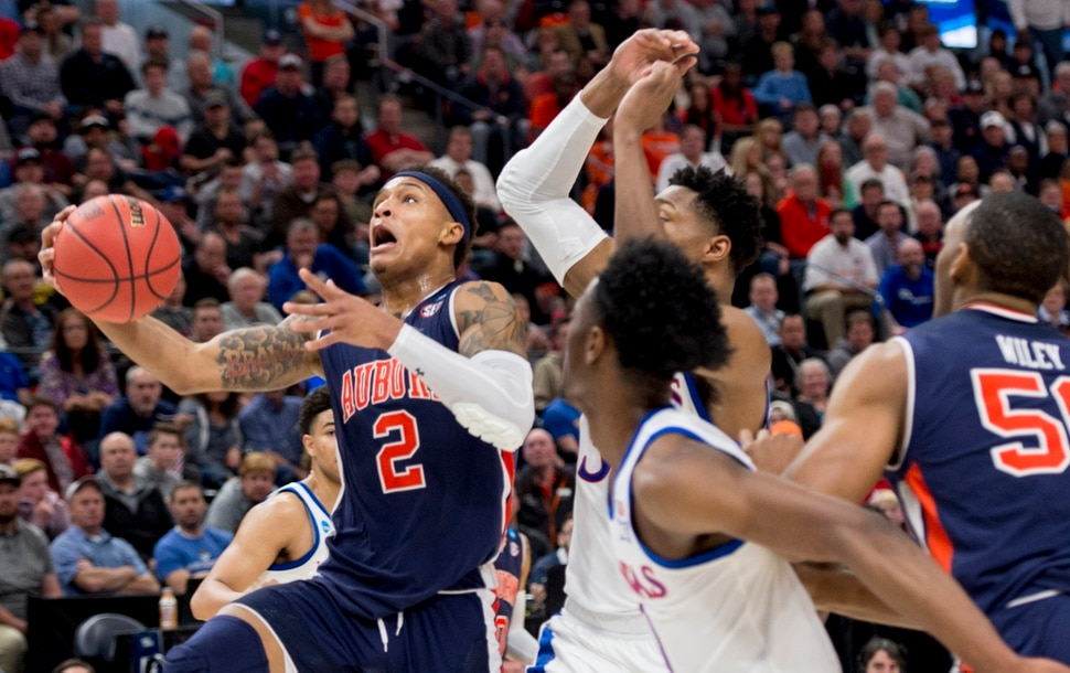 (Leah Hogsten | The Salt Lake Tribune) Auburn Tigers guard Bryce Brown (2) drives to the basket as Auburn faces Kansas in the second round of the NCAA tournament in Salt Lake City on Saturday, March 23, 2019.