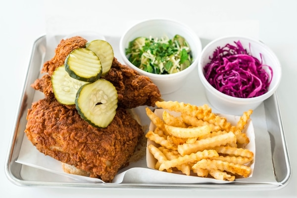 (Billy Yang | Pretty Bird) Nashville-style hot chicken with sides at Pretty Bird in Salt Lake City.