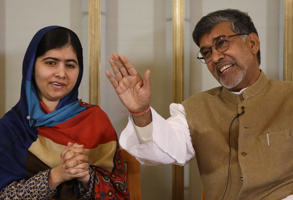 Joint-Nobel Peace prize winners Malala Yousafzai, left, and Kailash Satyarthi attend a press conference in Oslo, Norway, Tuesday, Dec. 9, 2014. (AP Photo/Matt Dunham)