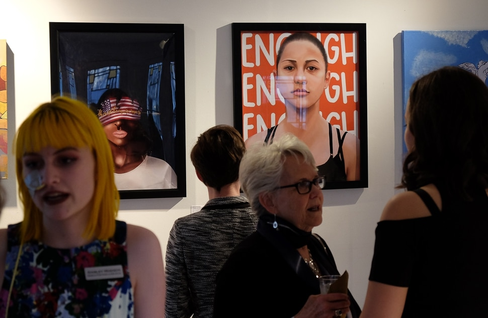 (Francisco Kjolseth   The Salt Lake Tribune) Presented by March for Our Lives Utah, students host a gala for gun reform at the Ladies Literary Club Clubhouse on Saturday, April 6, 2019, as people look through the art of a silent auction.