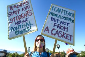 (Rick Egan  |  The Salt Lake Tribune)   Teacher Cara Bailey joins protesters during the Mask-In and Car Caravan protest at the State Capitol to demand the governor and other state and local leaders ensure that Utah schools protect students and staff when schools reopen, on Thursday, July 23, 2020.
