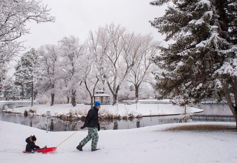 (Rick Egan | The Salt Lake Tribune) Jenda Michl pulls 4-year-old Mason Michl on a sled at Liberty Park, Friday, Nov. 29, 2019.