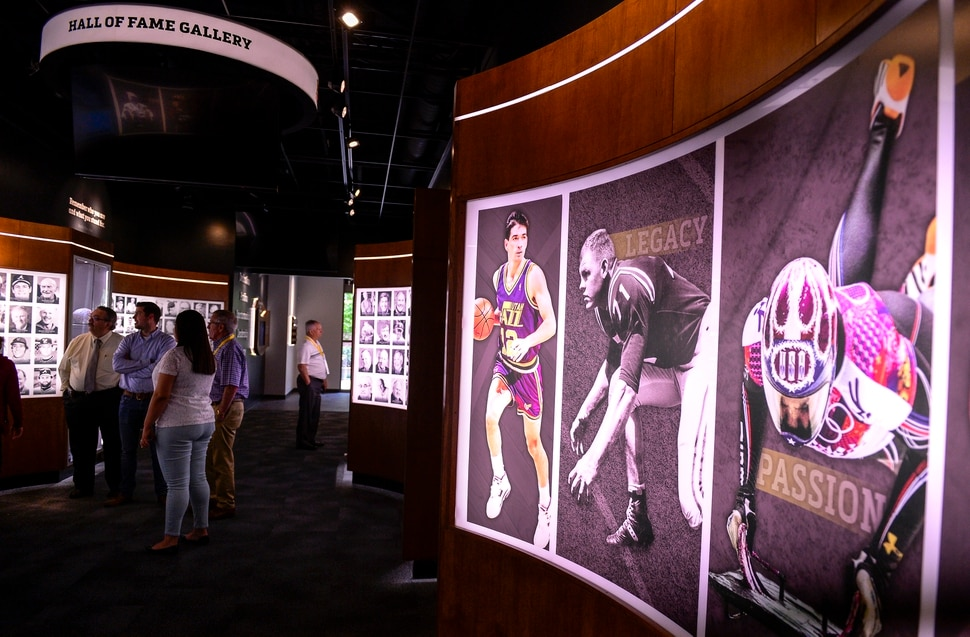 (Leah Hogsten | The Salt Lake Tribune) Visitors to the Utah Sports Hall of Fame tour the displays, Wednesday, May 15, 2019 before its grand opening this Saturday.
