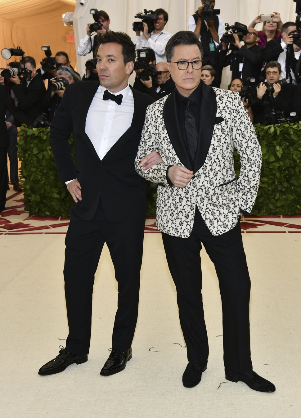Jimmy Fallon, left, and Stephen Colbert attend The Metropolitan Museum of Art's Costume Institute benefit gala celebrating the opening of the Heavenly Bodies: Fashion and the Catholic Imagination exhibition on Monday, May 7, 2018, in New York. (Photo by Charles Sykes/Invision/AP)