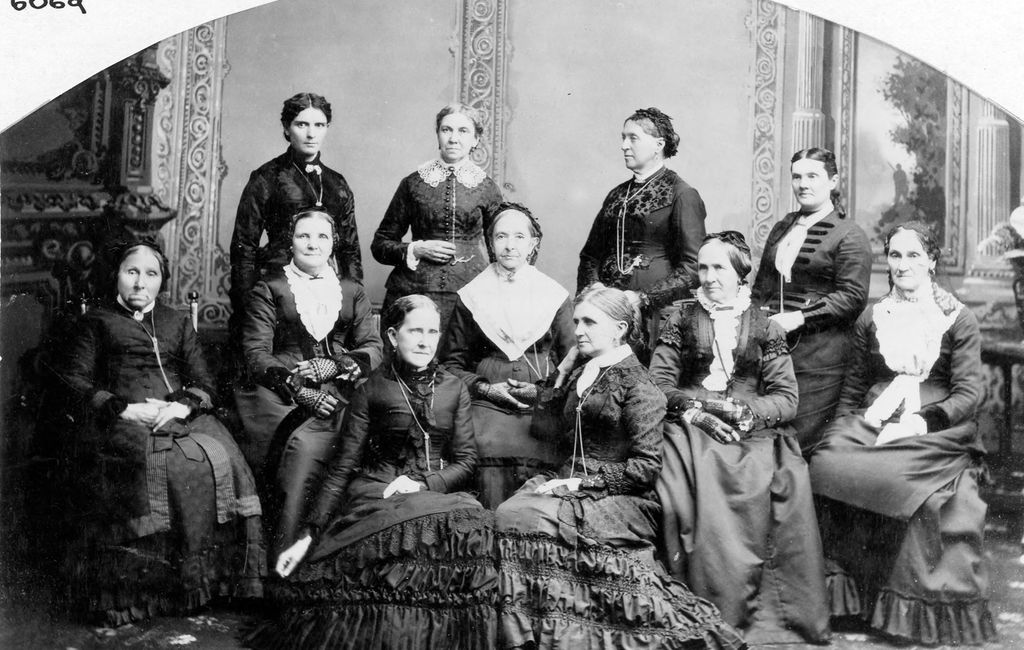 """(Photo courtesy Utah State Historical Society) This photo shows the board of directors of the Deseret Hospital. Many of the women in this photo participated in an 1870 meeting defending polygamy. The meeting was referred to as the """"Great Indignation Meeting."""" Front row, left to right: Jane S. Richards, Emmeline B. Wells.  Middle row: Phoebe Woodruff, Isabelle M. Horne, Eliza R. Snow, Zina D. Young, Marinda N. Hyde. Back row: Dr. Ellis R. Shipp, Bathsheba W. Smith, Elizabeth Howard, Dr. Romania B. Pratt Penrose."""