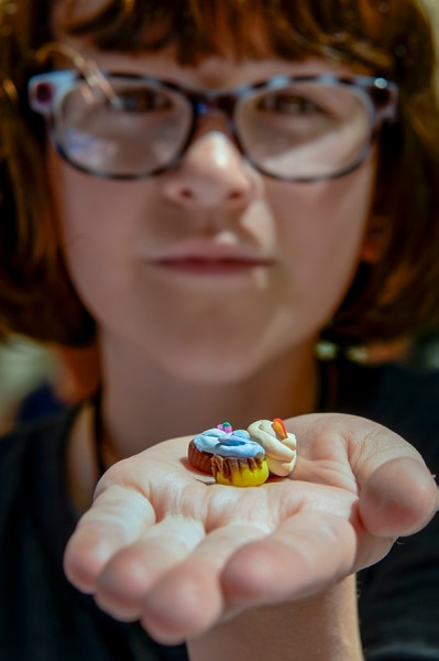 (Leah Hogsten   The Salt Lake Tribune) Imogen Nesse, 9, of Salt Lake City creates reproductions of food, including sushi, fudgesicles, cupcakes and heart-shaped waffles out of polymer clay at Craft Lake CityÕs DIY Festival Kid Row, where children 14 and under make and sell their products. Craft Lake CityÕs DIY Festival is UtahÕs largest local, three day arts festival with over 300 artisans, DIY engineers, vintage vendors and craft food creators.