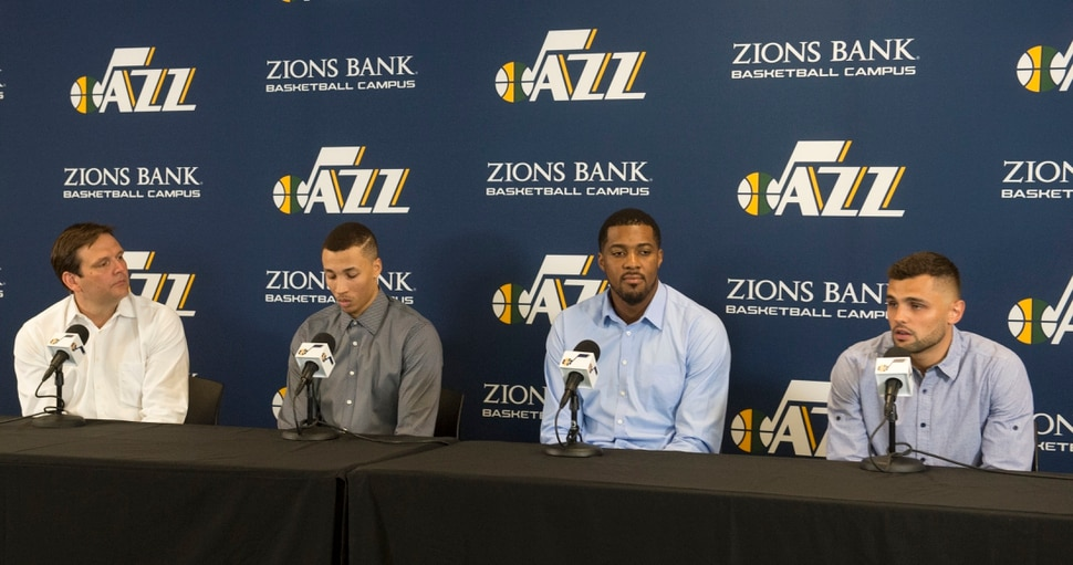 (Rick Egan | The Salt Lake Tribune) Dennis Lindsey and the re-signed free agents, Dante Exum, Derrick Favors and Raul Neto, at the Jazz practice facility, Friday, July 6, 2018.