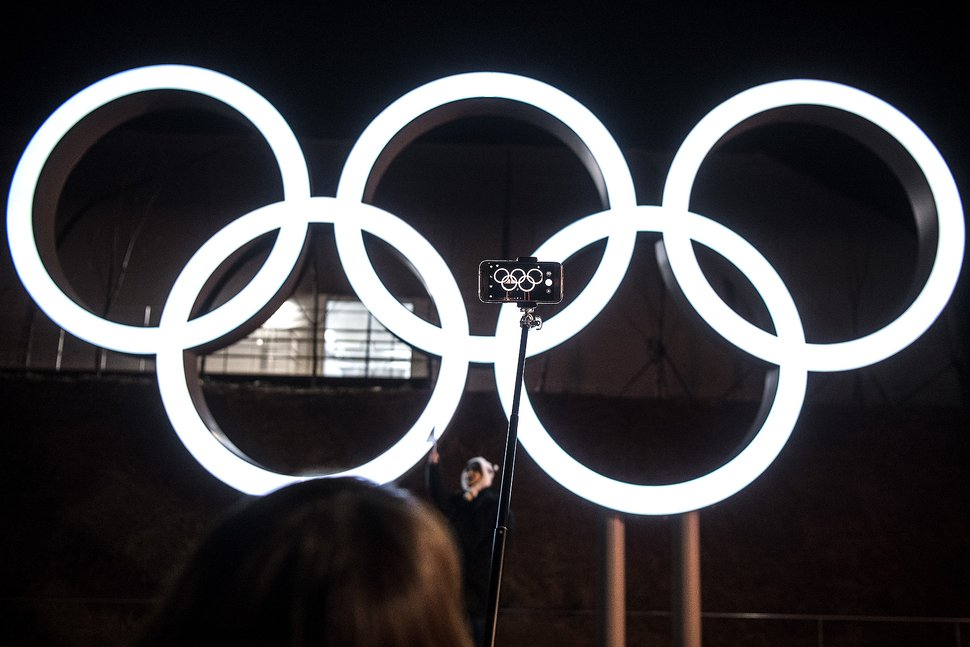 (Chris Detrick   The Salt Lake Tribune) Visitors take pictures with the Olympic rings during the PyeongChang 2018 Olympic Winter Games Closing Ceremony at Olympic Stadium Sunday, Feb. 25, 2018.