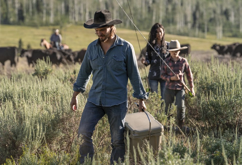 """(Photo courtesy of the Paramount Network) Luke Grimes as Kayce Dutton, Brecken Merrill as Tate Dutton and Kelsey Asbille as Monica Dutton in """"Yellowstone."""""""