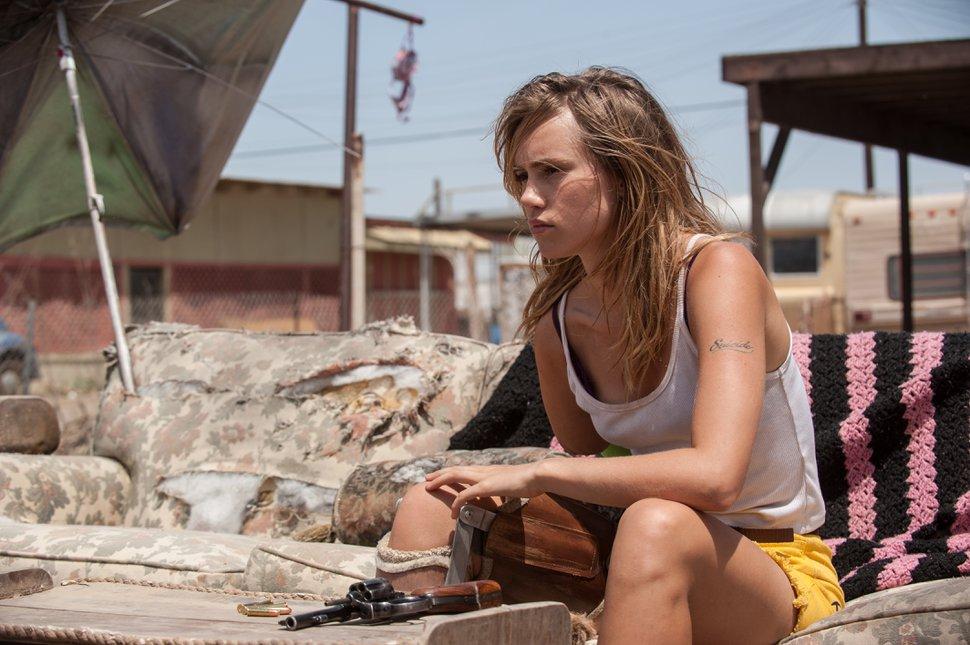 | Neon Films Arlen (Suki Waterhouse) loads her revolver, in a scene from the dystopian horror-thriller