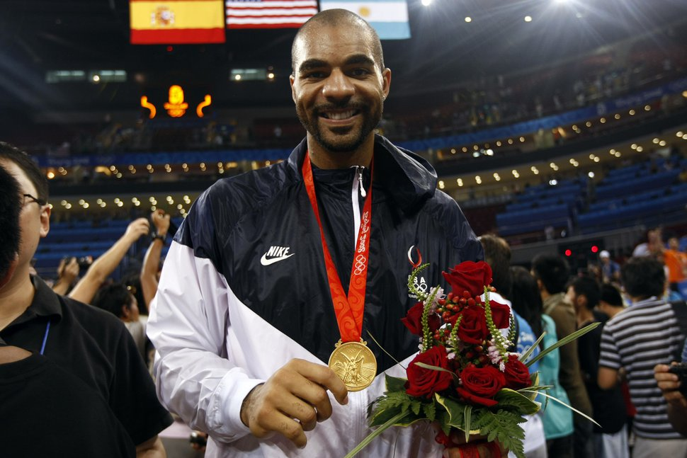 Chris Detrick | The Salt Lake Tribune USA's Carlos Boozer celebrates with his gold medal. The U.S. men's basketball team won the gold medal at the Beijing 2008 Olympic Games with a 118-107 victory over Spain at the Olympic Basketball Gymnasium, Sunday, August 24, 2008.