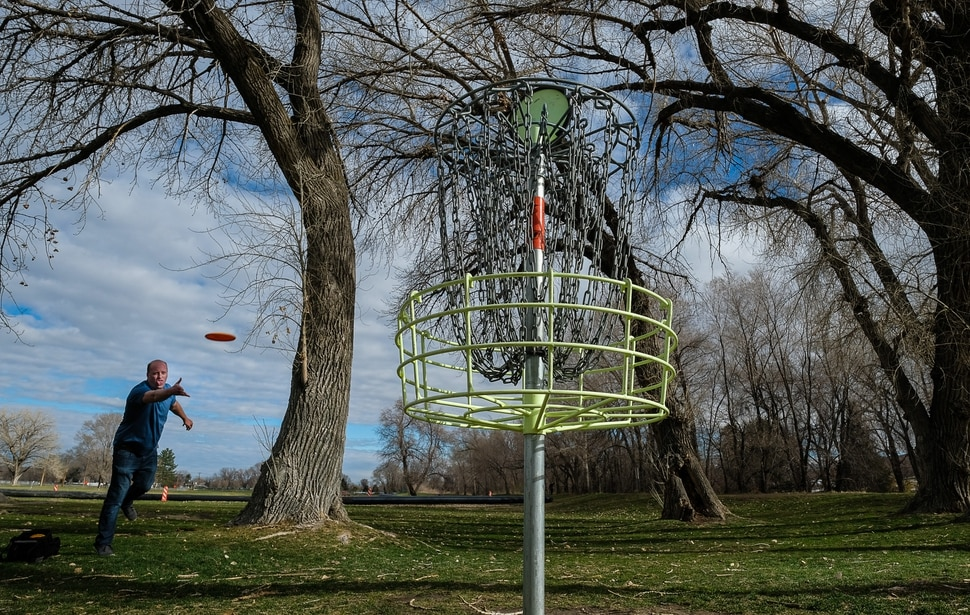 (Francisco Kjolseth | The Salt Lake Tribune) Long time disc golfer Nathan Ottesen of Orem tries out the Roots Disc Golf Course in the Rose Park neighborhood, site of one of the original disc golf courses in Utah before becoming a ball golf course for nearly 20 years. PGA Tour golfer Tony Finau grew up playing the Jordan River Par-3 course that has been converted back to a disc golf venue.