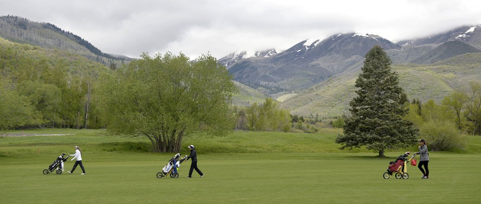 (Al Hartmann | Tribune file photo) Golfer walk in Wasatch Mountain State Park in Heber City on May 17, 2017. Wasatch County is one of America's fastest growing.