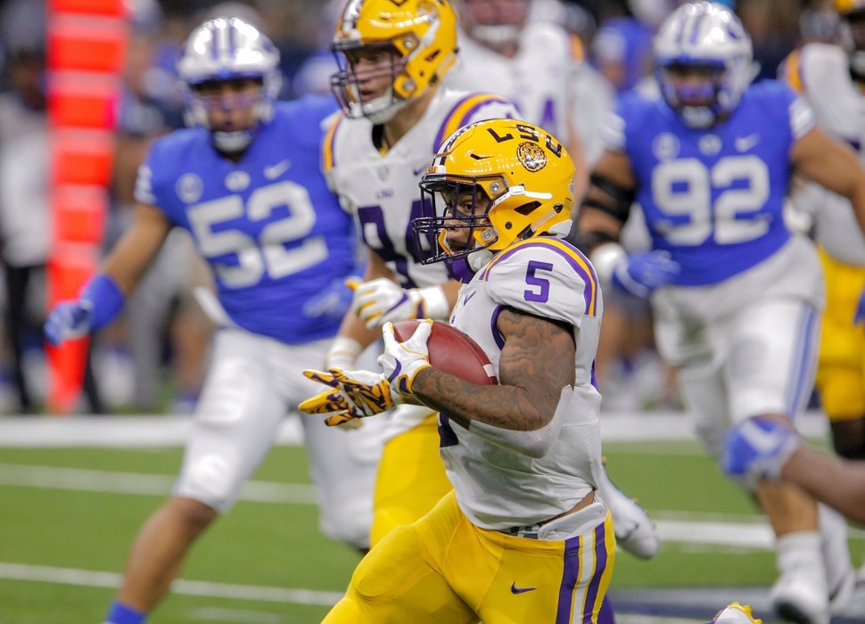 LSU running back Derrius Guice (5) runs against Brigham Young in the first half of an NCAA college football game in New Orleans, Saturday, Sept. 2, 2017. (AP Photo/Scott Threlkeld)