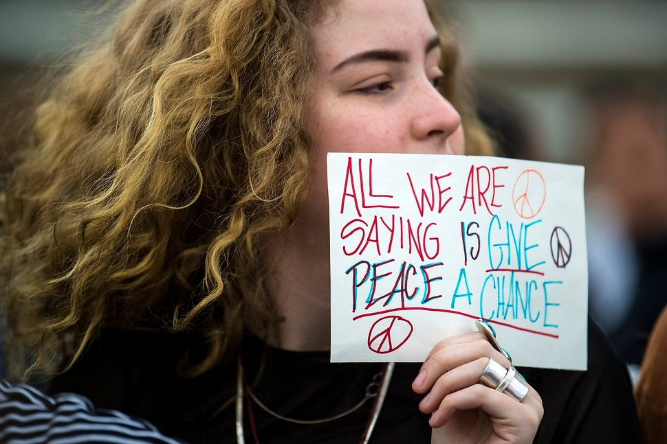 (Chris Detrick | The Salt Lake Tribune) Senior Zina Runyan participates in a nationwide demonstration for better gun safety laws at Highland High School in Salt Lake City Thursday, March 15, 2018. Students at more than 30 schools along the Wasatch Front, nearly all of them high schools, particiapted in the 17-minute walkout Ñ one minute for each of the Florida students killed.