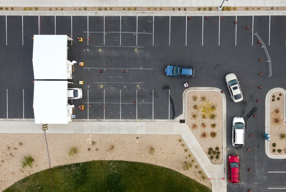 (Leah Hogsten | The Salt Lake Tribune) A line of cars bends around the University Of Utah Hospital's parking lot as people wait for COVID-19 testing in Farmington, Oct. 23, 2020.
