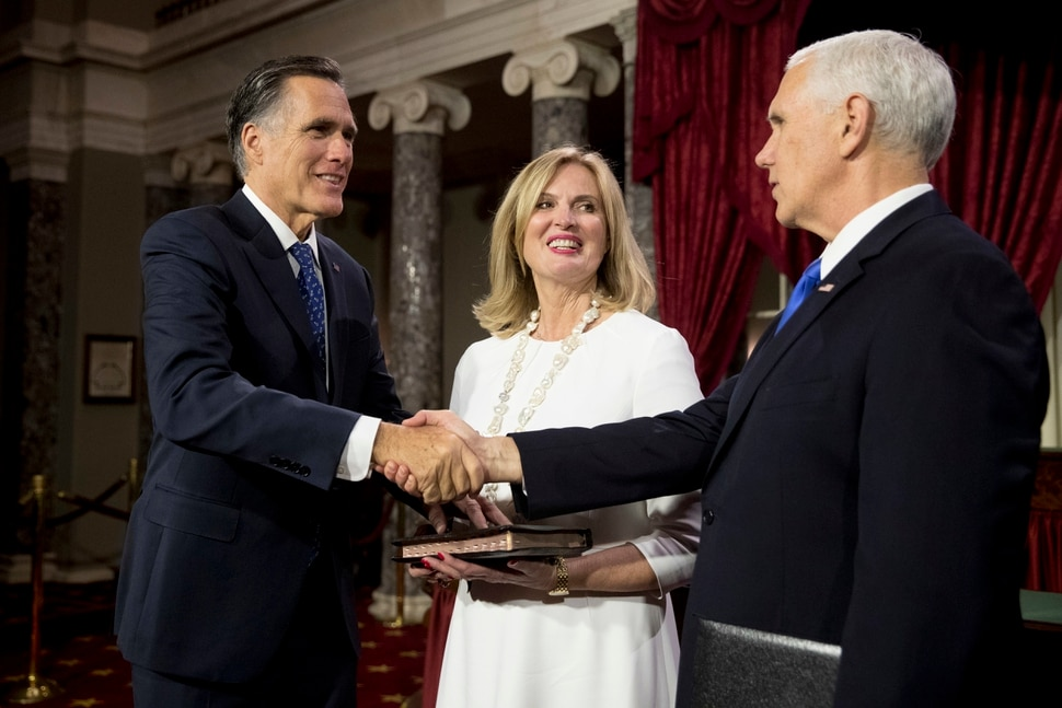 Vice President Mike Pence shakes hands with Sen. Mitt Romney, R-Utah, accompanied by his wife Ann, following a mock swearing in ceremony in the Old Senate Chamber on Capitol Hill in Washington, Thursday, Jan. 3, 2019, as the 116th Congress begins. (AP Photo/Andrew Harnik)