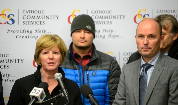 (Steve Griffin | The Salt Lake Tribune) Kathy Bray, of Volunteers of America, is joined by Utah Lt. Gov. Spencer Cox and others ass they urge Utahns to donate directly to service providers instead of donating directly to homeless individuals because of public safety and health concerns. The group held a news conference at the St. Vincent de Paul clothing room in Salt Lake City Monday December 11, 2017.