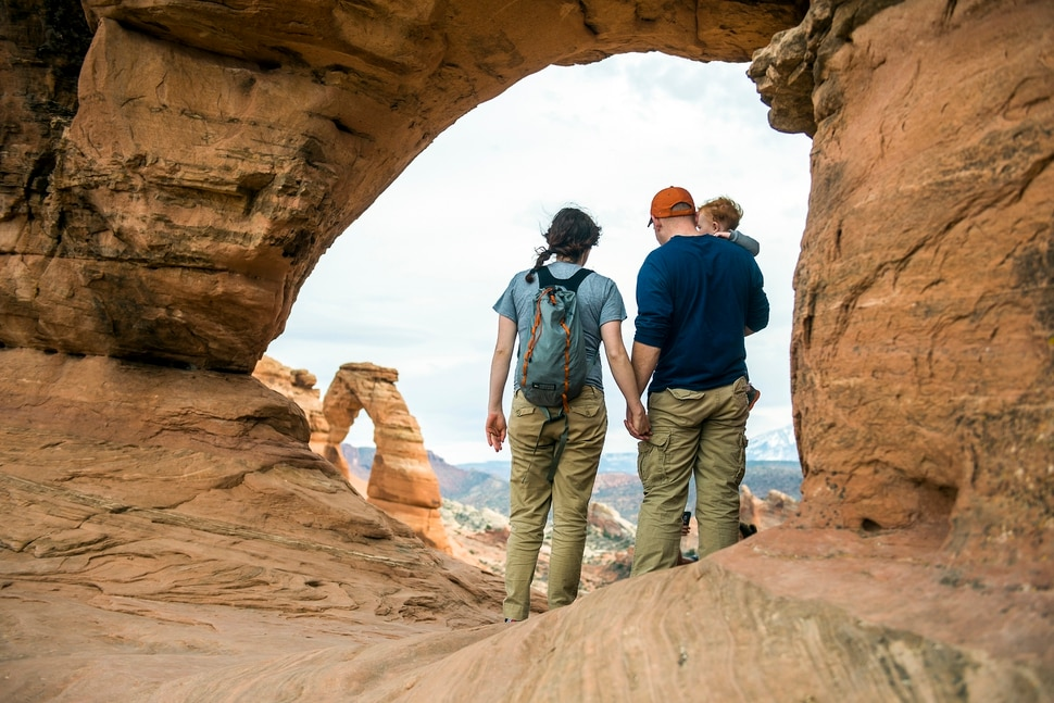 (Chris Detrick | The Salt Lake Tribune) A family looks at Delicate Arch in Arches National Park Saturday March 5, 2016.