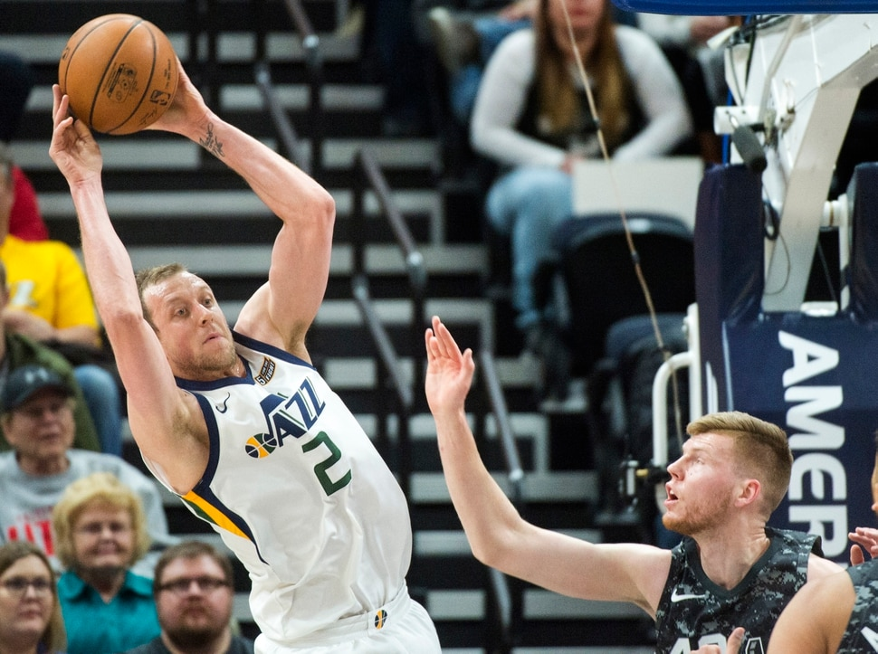 (Rick Egan | The Salt Lake Tribune) Utah Jazz forward Joe Ingles (2) tosses a pass back to the top, as San Antonio Spurs forward Davis Bertans (42) defends, in NBA action Utah Jazz vs San Antonio Spurs in Salt Lake City, Monday, February 12, 2018.