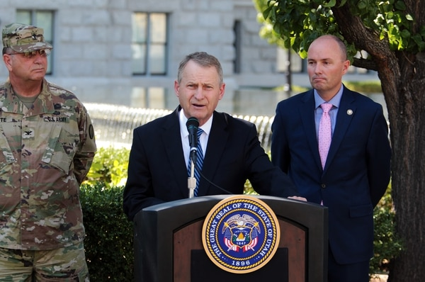 (Photo courtesy of The Church of Jesus Christ of Latter-day Saints) Elder LeGrand R. Curtis Jr. of the Seventy, center, is joined by Lt. Gov. Spencer Cox, right, and Gerald White, the state chaplain with the Utah National Guard to promote a weekend of prayer.
