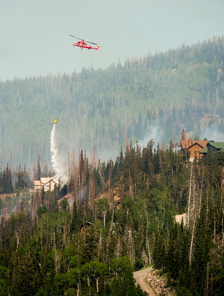 (Leah Hogsten | The Salt Lake Tribune) In this June 2017 file photo, firefighting crews and air tankers work to put out a wildfire along the Steam Engine area within Brian Head. The fire forced hundreds to evacuate from the southern Utah ski town.