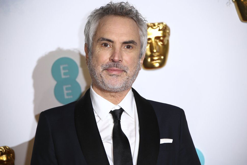 (Photo by Joel C Ryan | Invision/AP) Director Alfonso Cuaron poses for photographers upon arrival at the BAFTA awards in London, Sunday, Feb. 10, 2019.