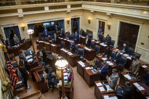(Rick Egan | Tribune file photo) Members of the Utah state Senate stand for amount of silence, in honor of the Gold Star families, on Thursday, Feb. 18, 2021. With less than two weeks left in the session, the pace is picking up as lawmakers jockey to advance hundreds of bills.