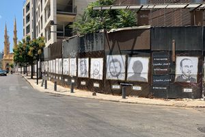 (Photo by Tala Shihab)  Downtown Beirut near the site of the Aug. 4, 2020, explosion. Images of the identified victims with their names stretch across the whole street.