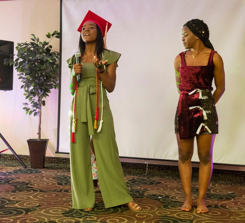 (Rick Egan | The Salt Lake Tribune) Academy of Math, Engineering and Science graduate Sylviane Bahati (left) talks about the dress she designed, modeled by her sister Nadine, during a fashion show, graduation celebration. Saturday May 25, 2019