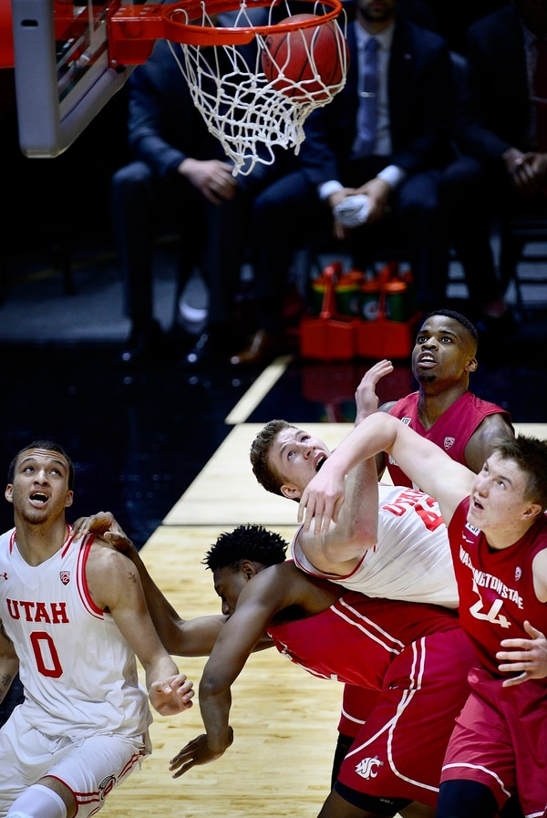 Scott Sommerdorf | The Salt Lake Tribune Utah Utes forward Jakob Poeltl (42) follows the ball as it rolls in while he gets caught up in the battle for rebound positioning underneath the basket. Utah routed Washington State 88-47, Sunday, February 14, 2016.