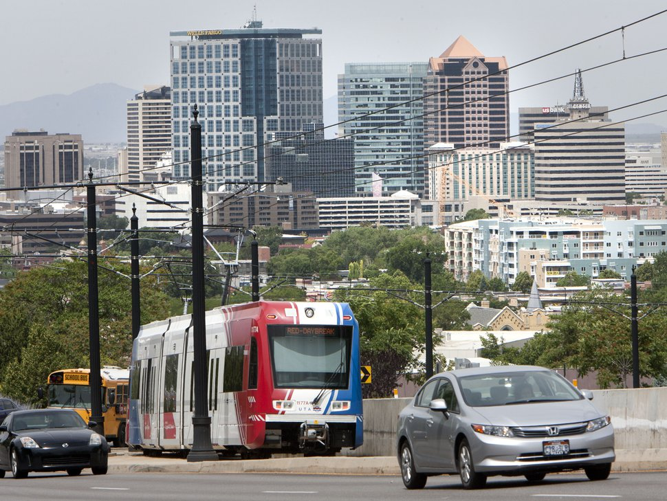 Steve Griffin | The Salt Lake Tribune A UTA TRAX train climbs out of downtown Salt Lake City as it heads to the University of Utah in Salt Lake City, Utah Monday June 24, 2013. The Salt Lake Chamber and its Utah Transportation Coalition has released a study on the impact of investing in UtahÕs transportation system.