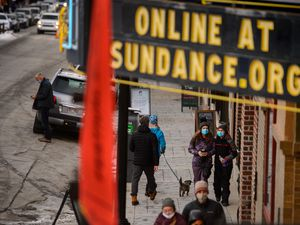 (Trent Nelson  |  The Salt Lake Tribune) Foot traffic in front of the Egyptian Theatre on Main Street in Park City on Tuesday, Jan. 12, 2021.