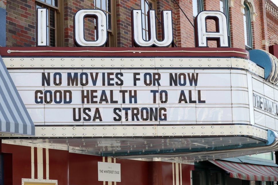(Charlie Neibergall | AP file photo) This Wednesday, April 1, 2020, file photo shows the marquee for the Iowa Theater, closed in response to the COVID-19 coronavirus outbreak, on John Wayne Drive in Winterset, Iowa. The state is getting testing help from Utah technology companies.