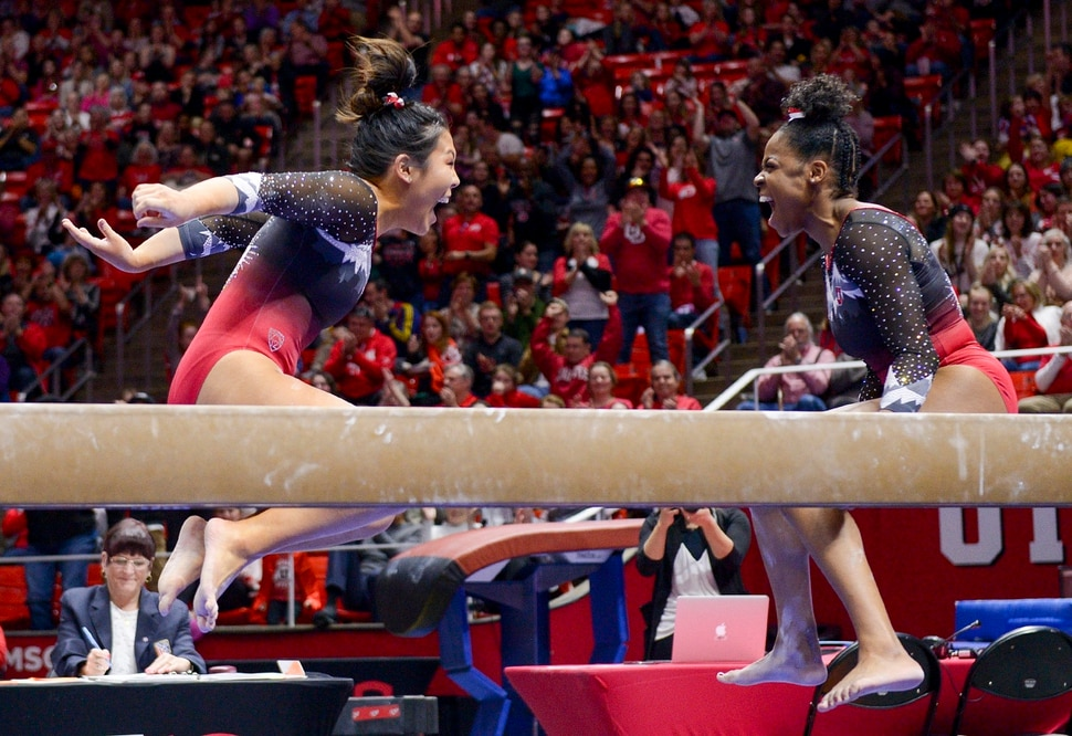 (Leah Hogsten | The Salt Lake Tribune) l-r Utah's Cristal Isa during her 9.950 performance on the beam with teammate Cammy Hall. The University of Utah Red Rocks defeated Oregon State, 197.100 to 196.275, Saturday, Feb. 15, 2020 at the Jon M. Huntsman Center.