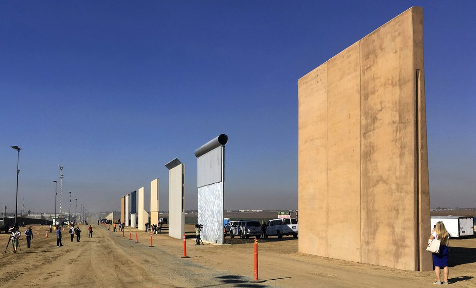 FILE - This Oct. 26, 2017, file photo shows prototypes of border walls in San Diego. (AP Photo/Elliott Spagat, File)