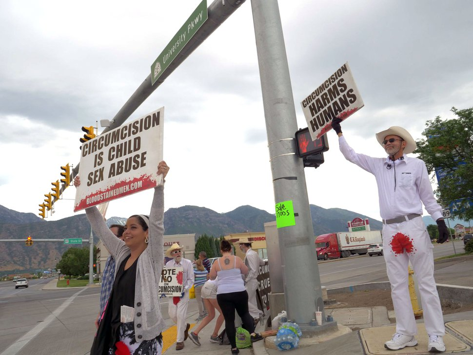(Photo courtesy of James Loewen) Anti-circumcision advocates hold a demonstration in Orem on July 13, 2019.