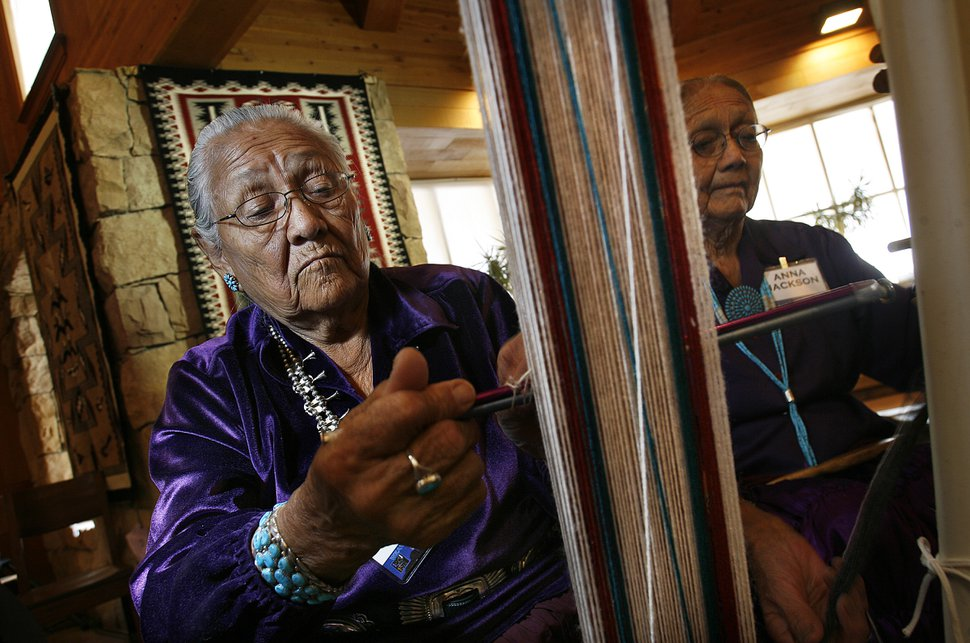 (Scott Sommerdorf | Tribune file photo) As part of the nonprofit Adopt-A-Native-Elder Program, Frances Bahe weaves a belt in 2012 while students from Salt Lake City and Park City watch at Deer Valley Resort. The small nonprofit receives funding from Salt Lake County for its cultural programming.