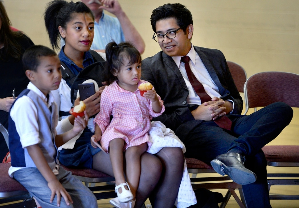(Scott Sommerdorf | The Salt Lake Tribune) Dreamer and activist Deyvid Morales sits with his family prior to speaking at the rally entitled #SummerResistance Day of Action: Protecting DACA, put on by the Utah State Democratic Party and Utah State Democratic Hispanic Caucus at the Centro Civico Mexicano, Sunday, August 20, 2017. From left: Mafi Sili - 4, wife Siosiani Sili, Lala Morales - 2, and Manny Morales (in Siosiani's arms), and Deyvid Morales, right.