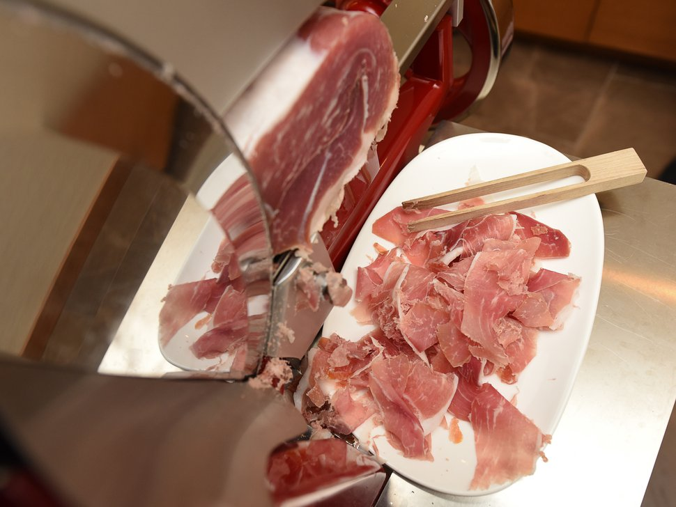 (Francisco Kjolseth | The Salt Lake Tribune) The new AC Hotel in Salt Lake City has a $10,000 Berkel prosciutto slicer. Fire-engine red with chrome trim and a flywheel that turns manually, it cuts prosciutto paper thin for the hotel's daily continental breakfast.