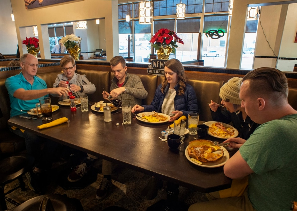 (Rick Egan | The Salt Lake Tribune) The Eyre family — Ron, Julianne, Kaden, Ashley, Channing and Jordan — dine at Tru Religion Pancake & Steakhouse, which opened recently in Orem. The new restaurant features the antique furniture from Salt Lake City's Lamb's Grill. Friday, Dec. 28, 2018.