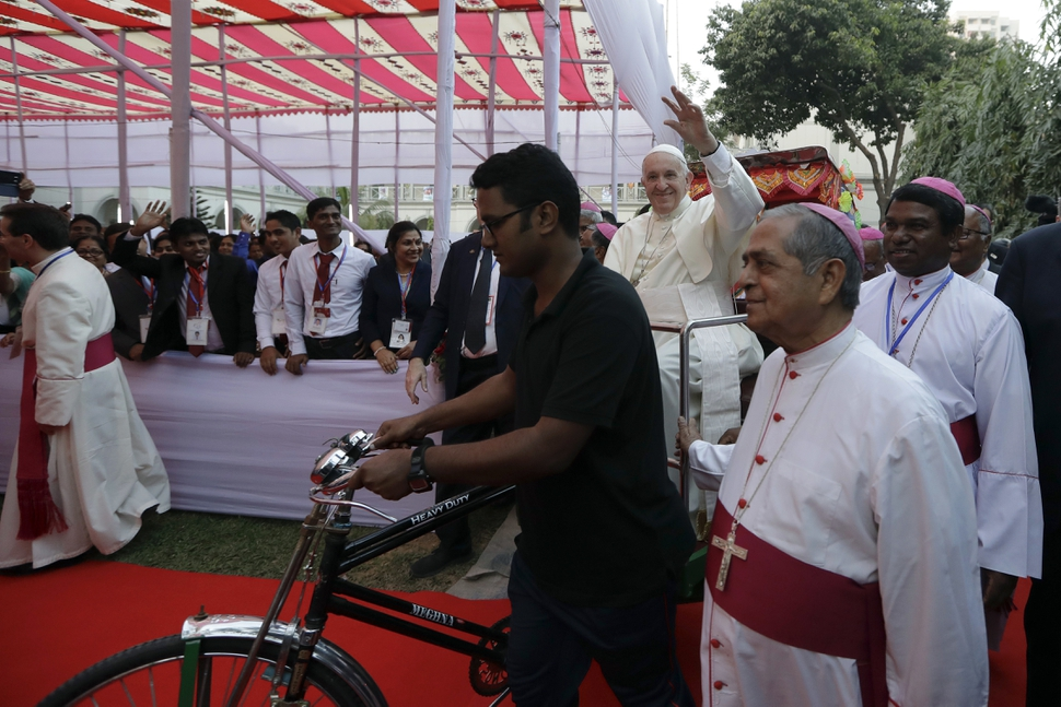 (Andrew Medichini | The Associated Press) Pope Francis rides a traditional Bangladesh rickshaw as he arrives at an interfaith and ecumenical meeting for peace in the garden of the archbishop's residence, in Dhaka, Bangladesh, Friday, Dec. 1, 2017.