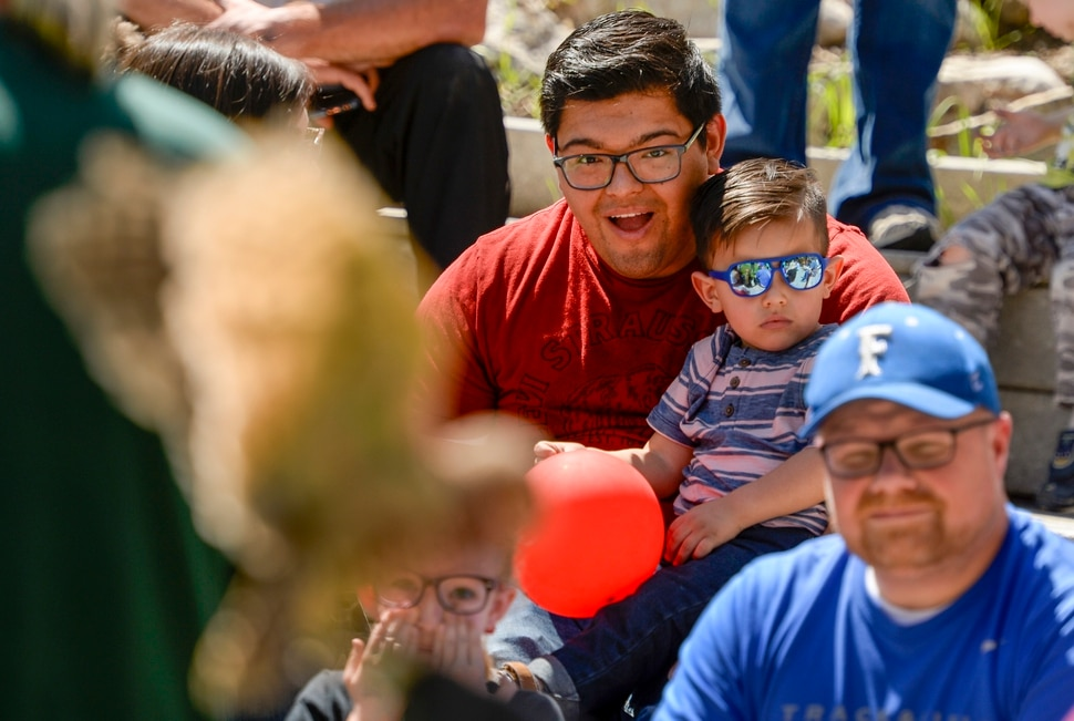Leah Hogsten | The Salt Lake Tribune Ricardo Paez, holding his son Izan, 2, watches a burrowing owl flap its wings as the two learn all about owls including barn, screeh, great horned owls during Earth Day celebration at the Ogden Nature Center, Saturday, April 20, 2019.
