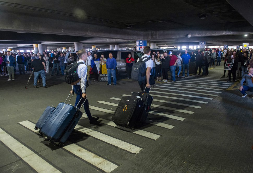 (Rick Egan | Tribune file photo) In this Sunday, March 22, 2020, photo, hundreds of people gather to welcome missionaries returning home from the Philippines at the Salt Lake City International Airport.