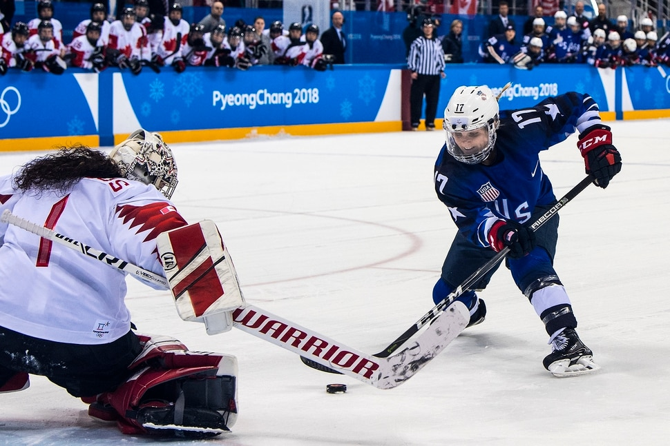 (Chris Detrick | The Salt Lake Tribune) United States forward Jocelyne Lamoureux-Davidson (17) shoots past Canada goaltender Shannon Szabados (1) during the Women's Gold Medal Game at Gangneung Hockey Centre during the Pyeongchang 2018 Winter Olympics Thursday, Feb. 22, 2018. United States defeated Canada 3-2 in a shootout victory.