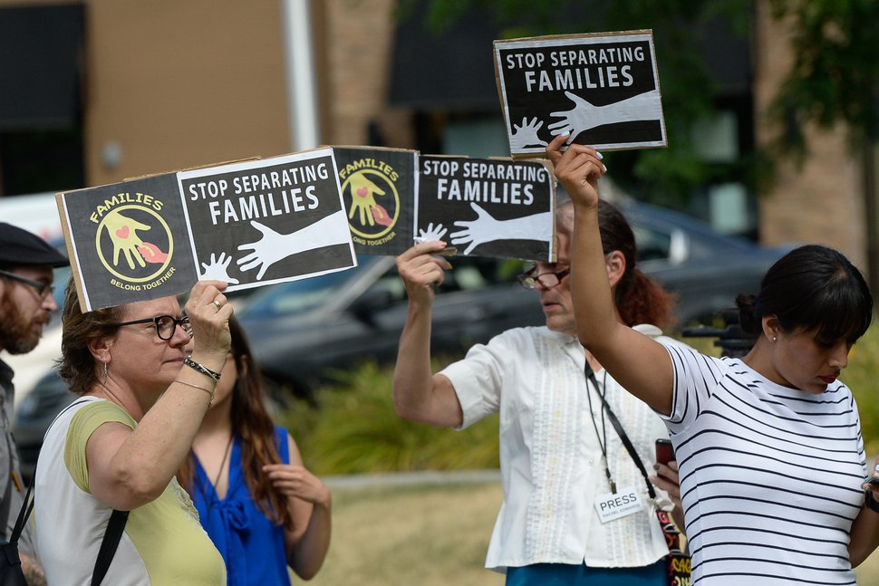 (Francisco Kjolseth | Tribune file photo) Activists stage a protest against a private prison company with contracts to hold undocumented immigrants on Thursday, July 12, 2018, at the headquarters of Management and Training Corporation in Centerville.
